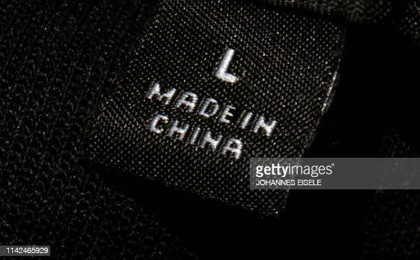 A photo illustration shows a label inside an item of clothing reading Made in China in New York on May 09 2019 US and Chinese officials resumed...