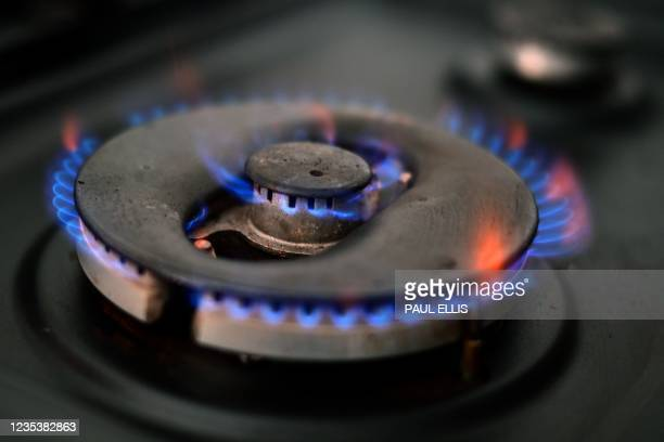 Photo illustration shows gas burning on a domestic hob in Liverpool, north-west England on September 20, 2021. - The UK government was on Monday...