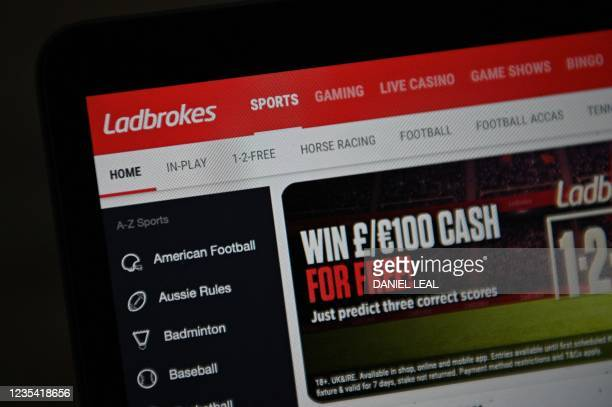 Photo illustration shows the website of Ladbrokes betting shop, owned by Entain, in London on September 22, 2021. - UK gambling giant Entain said on...