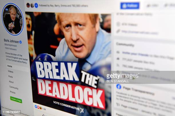 A photo illustration taken in London on December 6 shows the Facebook page of Britain's Conservative Party Leader and Prime Minister Boris Johnson...