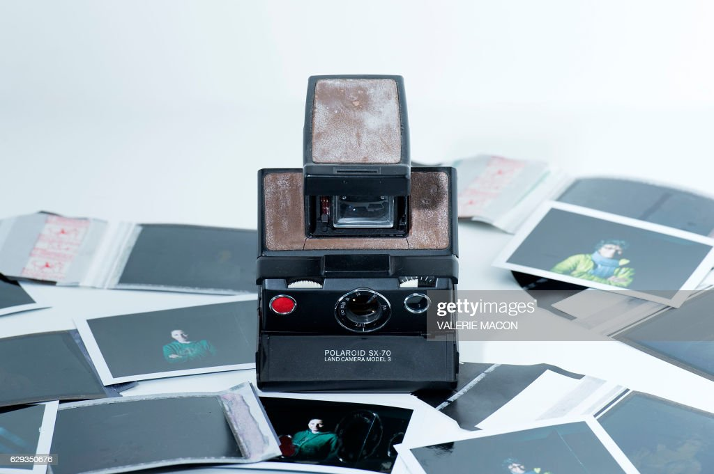 A photo illustration view of an old Polaroid Camera and some instant films are seen on December 12, 2016 In Los Angeles, California. - At a photography studio in Cleveland, instructor Nicole Follen is trying to convince her students to step back in time and technology -- to the age of the humble Polaroid. She wants the students to create something they can touch and feel -- perhaps even something that gasp -- isn't perfect.