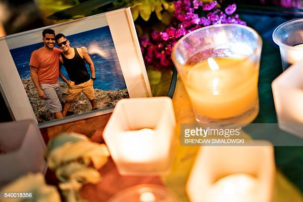 A photo is seen in a memorial after a vigil outside the Dr Phillips Center for the Performing Arts for the mass shooting victims at the Pulse...