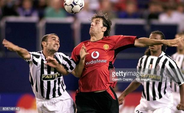 LEAGUE Photo issued Friday August 1 of Manchester United's Ruud Van Nistelrooy battling for the ball with Juventus's Paolo Montero during their...