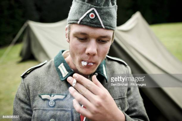 Photo Kris Hodge 19 dressed as a German Infantry soldier Private First Class takes a drag of his rollup cigarette at the WWII Weekend at Castle Drogo...