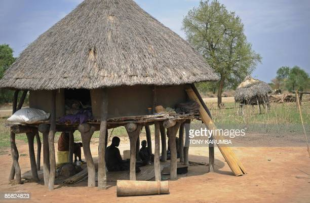 Photo made April 02, 2009 shows a south Sudanese family sheltering from the mid-morning heat underneath their granary at Terekeka, 51 miles north of...