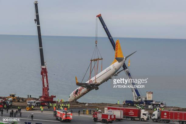A photo made available by the Dogan News Agency shows the Pegasus Turkish passenger plane being lifted by cranes on January 18 five days after it...
