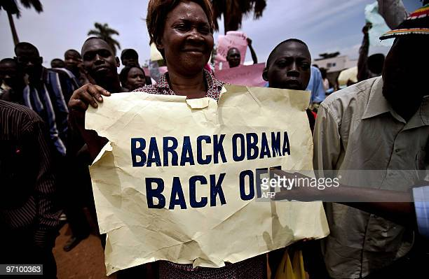 Photo made on February 14 2010 shows a woman holding a placard as she takes part in an antigay demonstration in Jinja Kampala On February 17 2010 a...