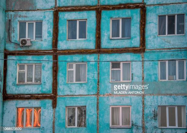 A photo made on November 26 2018 shows a cracked and partially repaired panel apartment building in the eastern Siberian city of Yakutsk Many houses...