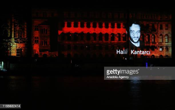 A photo martyred Halil Kantarci is reflected on the wall of Haydarpasa Terminal during the Mapping show for July 15 Democracy and National Unity Day...
