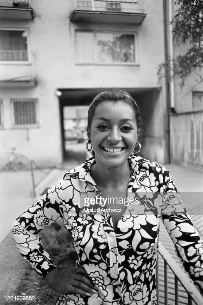Photo model Marielle doing a photo shoot, Germany, 1960s.