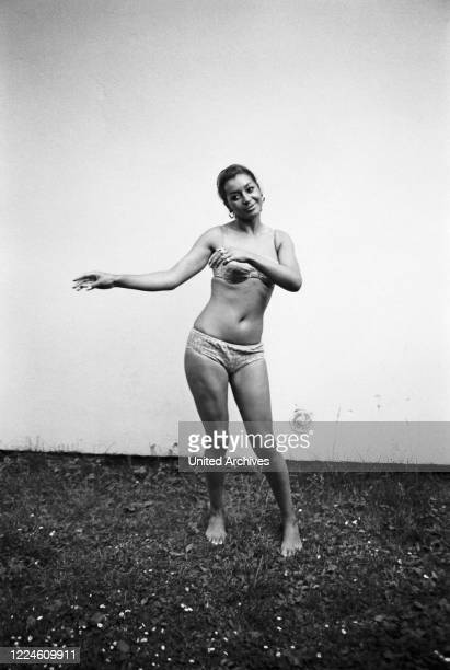 Photo model Marielle doing a photo shoot wearing swimsuit, Germany, 1960s.
