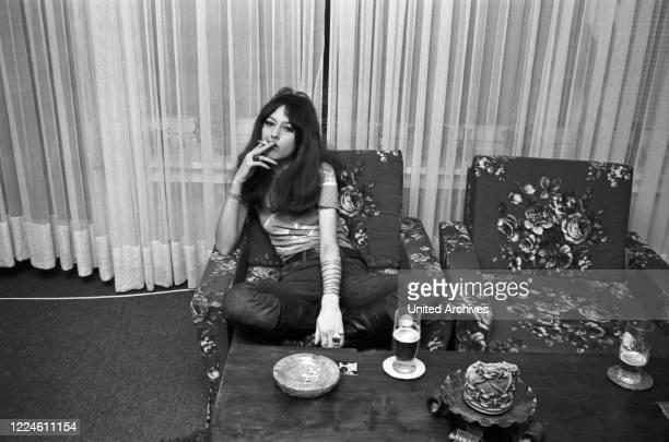 Photo model Uta Reichenvater doing a photo shoot, Germany, 1960s.
