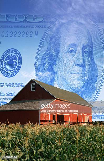 American currency red barn and corn field