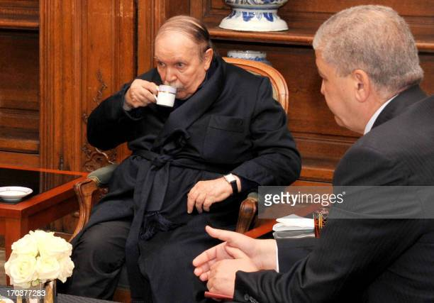 A photo obtained on June 12 2013 from Algerian Press Service news agency shows Algeria's President Abdelaziz Bouteflika drinking tea as he receives...