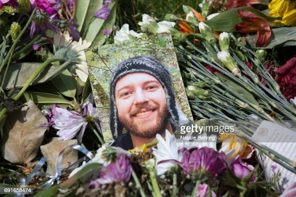A photo of 23yearold Taliesin Myrddin Namkai Meche who was fatally stabbed last week is seen an impromptu memorial at the Hollywood Transit Center on...