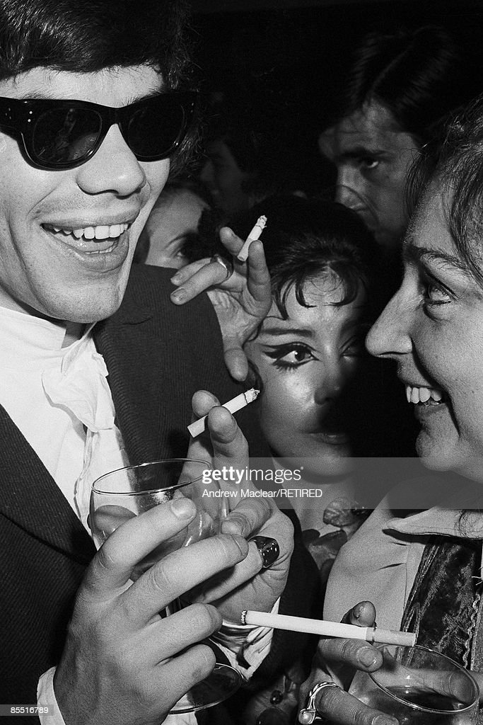 Photo of 60's; Clubber inside The Revolution Club, sunglasses and smoking cigarette