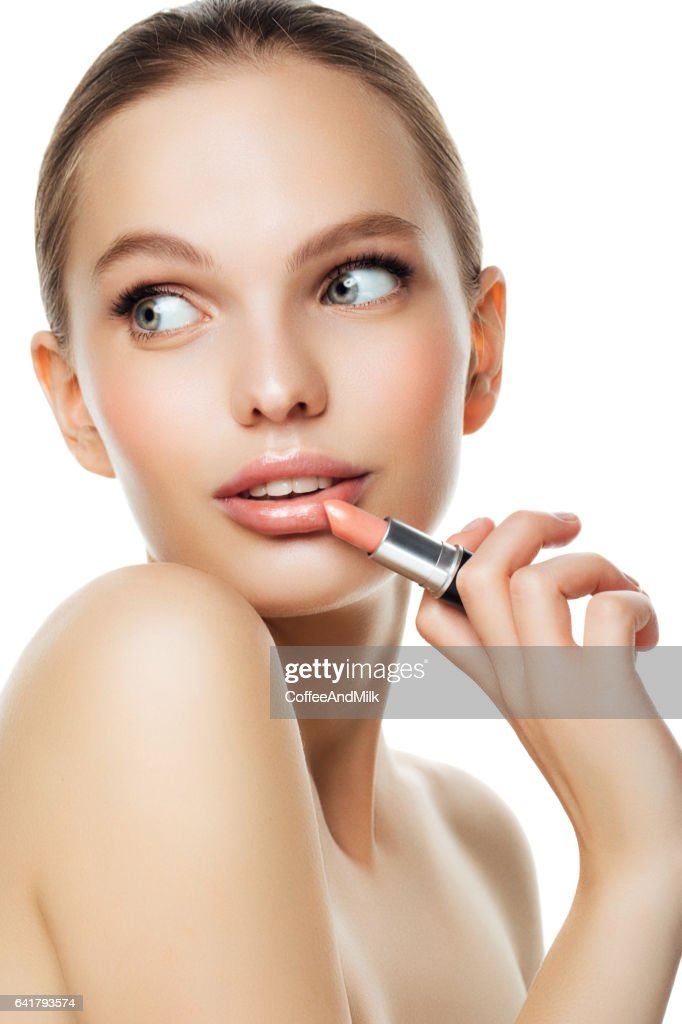 Photo of a beautiful girl with lipstick : Stock Photo