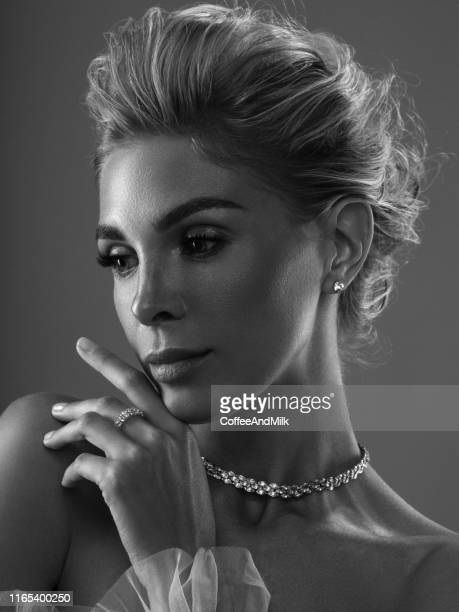 photo of a beautiful woman with jewelry - glamour stock pictures, royalty-free photos & images