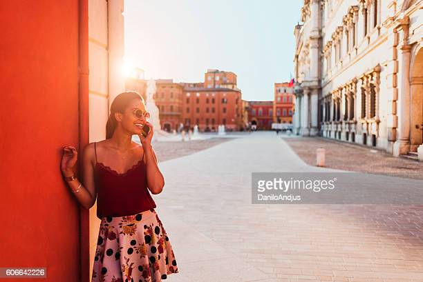 photo of a beautiful young woman talking on her smartphone