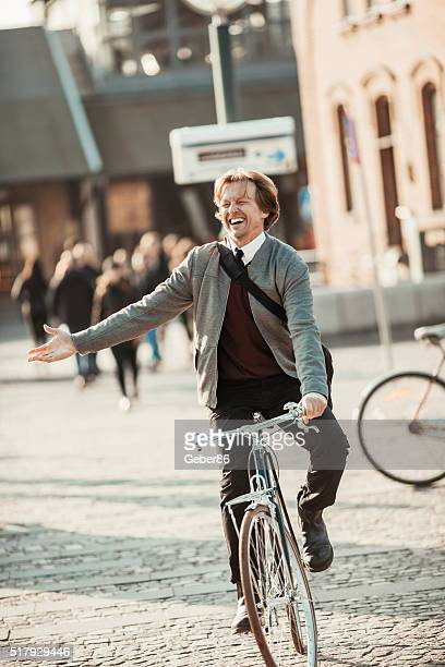 Photo of a businessman cycling to his job
