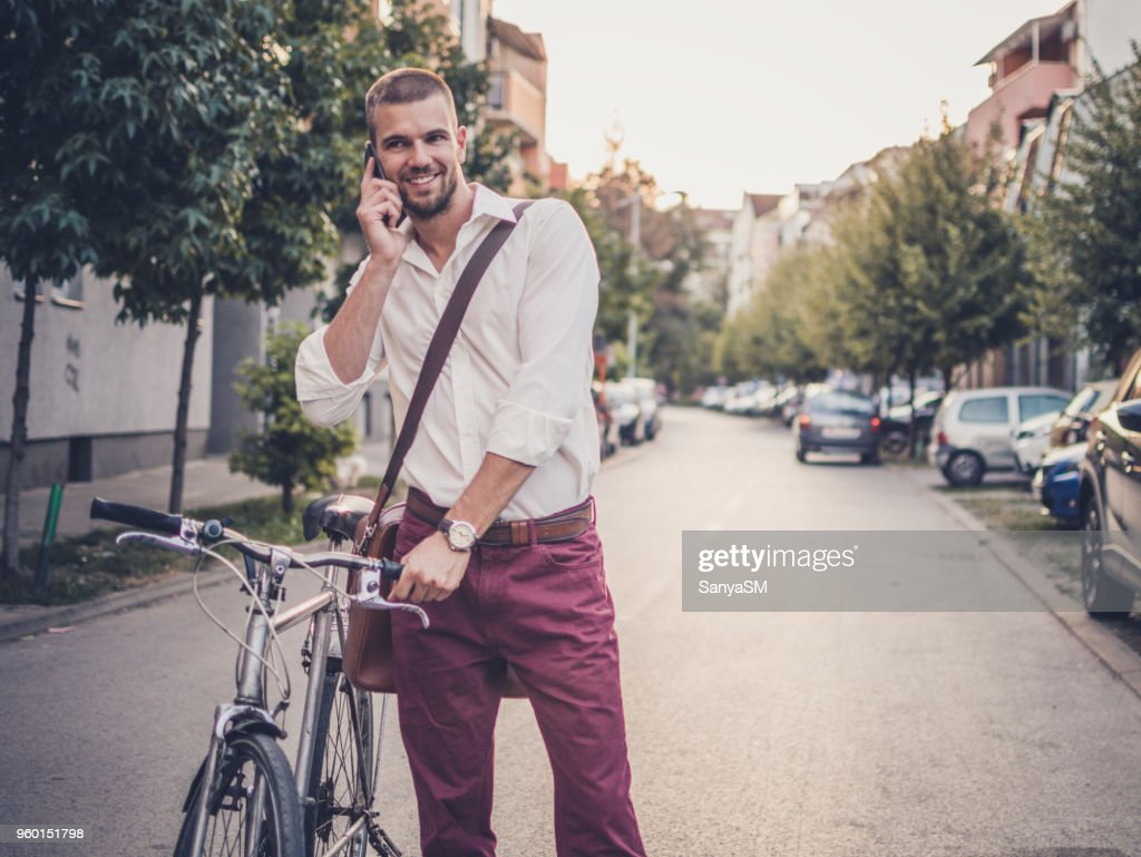 Photo of a businessman talking on mobile phone : Stock Photo