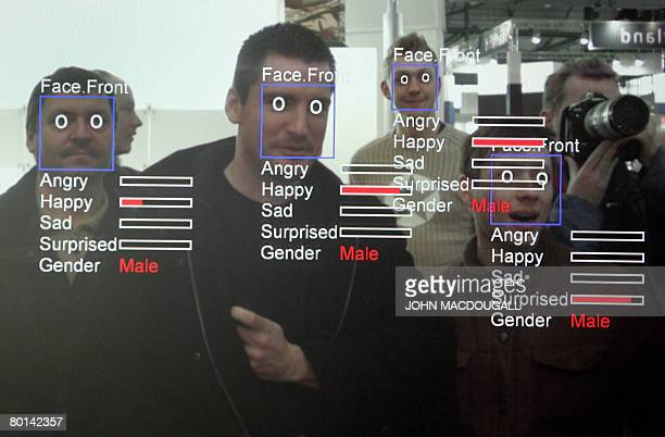 A photo of a computer screen running 'Real Time Face Detector' software shows visitors' expressions analysed and explained in real time at the stand...