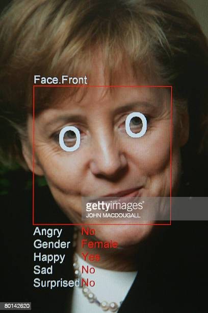 A photo of a computer screen running 'Real Time Face Detector' software shows a photo of German Chancellor Angela Merkel analysed and explained in...