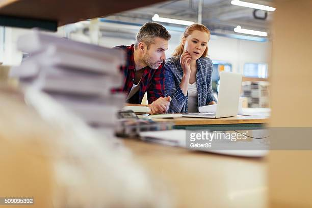 photo of a coworkers in printing factory - printing plant stock pictures, royalty-free photos & images