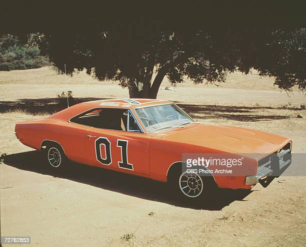 Photo of a Dodger Charger named the 'General Lee' which was used in the American television show 'The Dukes Of Hazzard' as it sits parked near a tree...