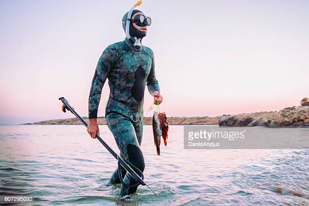 photo of a freediver coming back from spear fishing