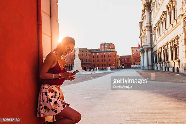photo of a gorgeous woman using her smartphone