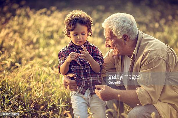 Photo of a grandfather outdoors with his grandson
