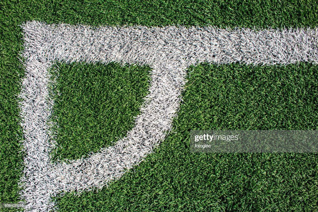 grass field from above. Grass Field From Above. Photo Of A Green Synthetic Sports With  White Line Above