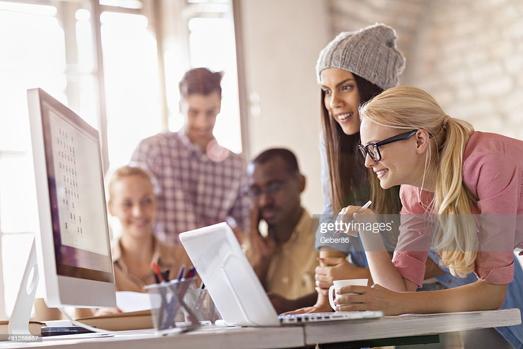 Photo of a group of designers working together : Stock Photo