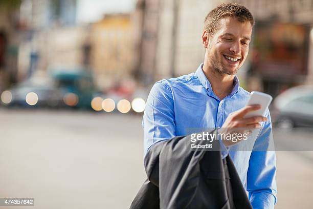 Photo of a handsome businessman using smart phone