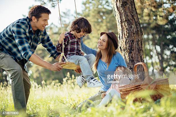 Photo of a happy family enjoying fun time in forest