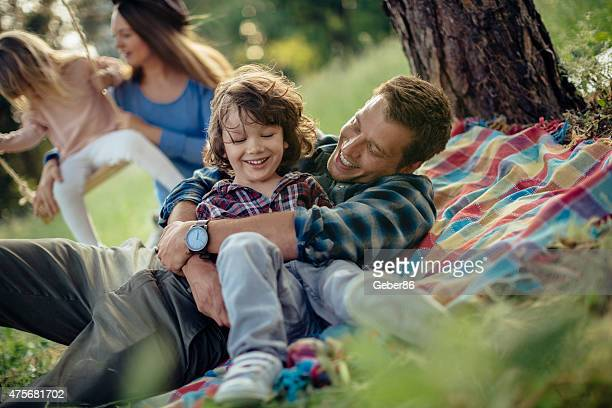 Photo of a happy family having picnic in the forest