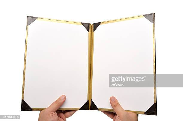 A photo of a menu opened to a empty pages