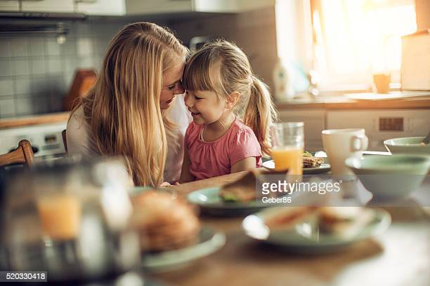 photo of a mother and daughter having breakfast - nordic countries stock pictures, royalty-free photos & images