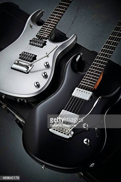 Photo of a Music Man Luke III and a Music Man JP13 electric guitar created to the specification of Toto's Steve Lukather and Dream Theater's John...