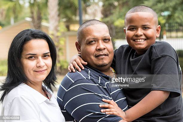 photo of a real hispanic family. - chubby boy stock photos and pictures