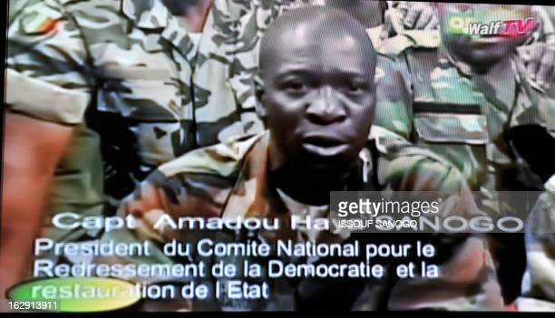 Photo of a TV screen taken on March 22 2012 shows Mali junta leader Captain Amadou Sanogo announcing a curfew in Bamako starting from March 22...
