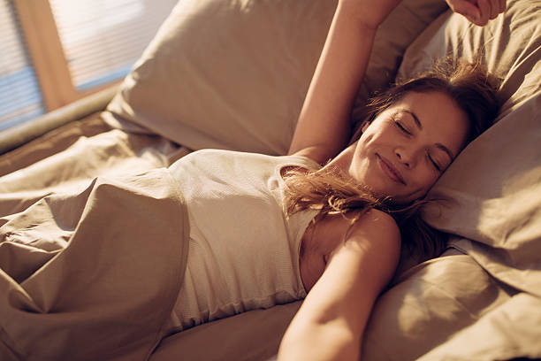 photo of a woman waking up - wake up stock pictures, royalty-free photos & images