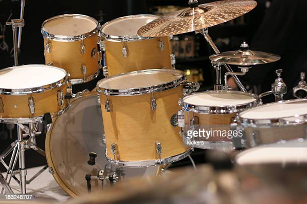 photo of a yellow drum set on black - drum kit stock photos and pictures