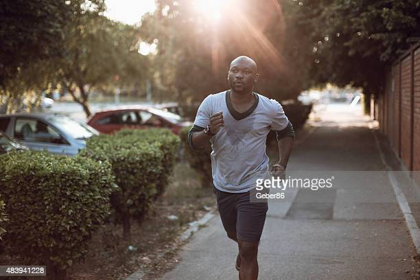 Photo of a young athletic man running