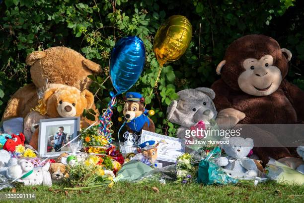 Photo of a young boy, believed to be Logan Williamson, is left amongst the floral tributes near the scene where the body of five-year-old Logan...