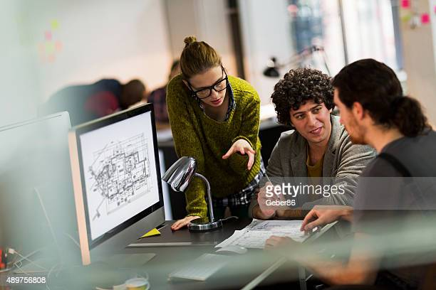 Photo of a young designer team in office