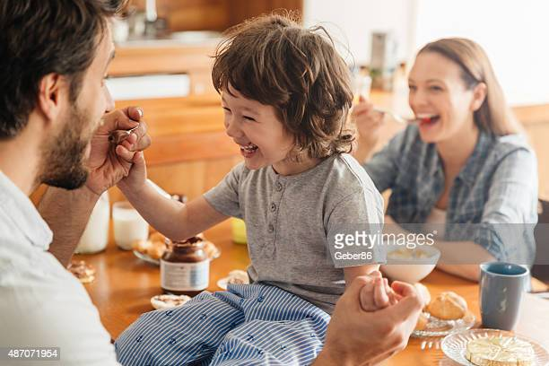 photo of a young happy family having breakfast - share my wife photos stock photos and pictures