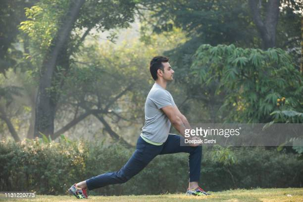 photo of a young man - stock image - warming up stock pictures, royalty-free photos & images