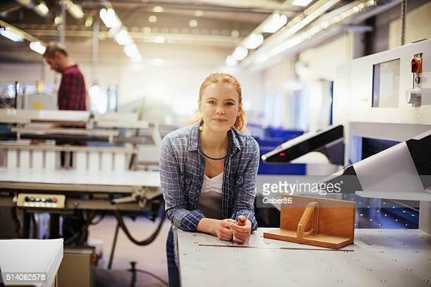Photo of a young woman in printing factory